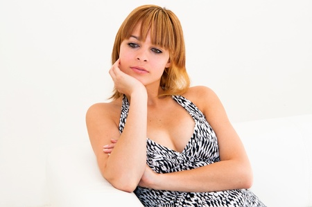 portrait of young woman holding her face on the couch in the living room Stock Photo - 9661680