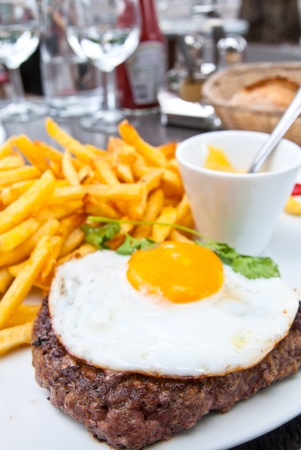 juicy steak beef meat with french fries and poached eggs photo