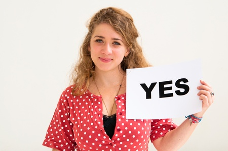 happy portrait young woman with board yes  photo