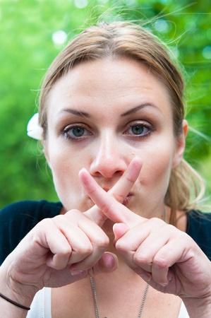 hushing: Portrait of a beautiful young fresh girl hushing