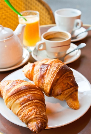 Breakfast with coffee and croissants in a basket on table Stock Photo - 10087946