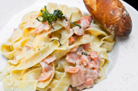 close-up of plate of pasta and smoked salmon photo