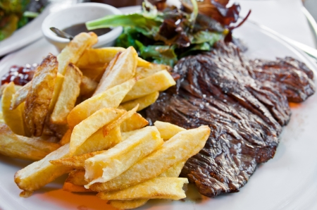 potato fries: juicy steak beef meat with tomato and potatoes