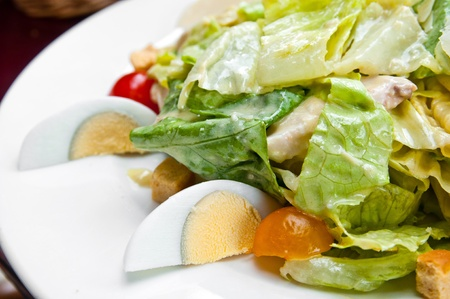 Fresh salad - Delicious fresh salad with tomatoes, lettuce, eggplant, zucchini, cheese, parma ham and olive oil. Stock Photo - 10305725