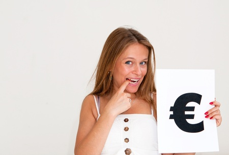 portrait young woman with board euro mark Stock Photo - 10305715