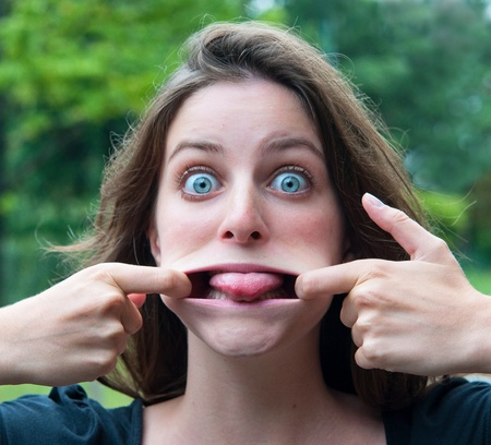 expression-Young woman making a funny grimace Stock Photo - 10427947