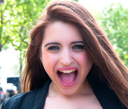 Young woman screaming with crazy expression Stock Photo - 10510212