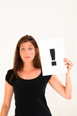 portrait young woman with board exclamation point photo