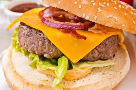 Cheese burger - American cheese burger with fresh salad Stock Photo - 10724292