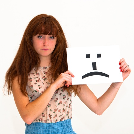 portrait young woman with board sad emoticon face sign Stock Photo - 10724105