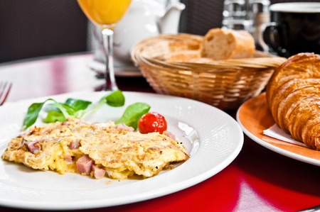 omelet with ham tomato and green salad photo