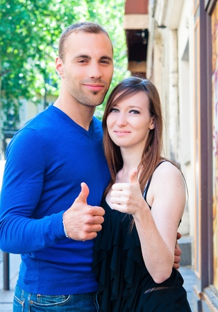 Young couple in love smiling in the streets photo