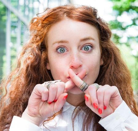 Portrait of a beautiful young fresh girl hushing photo