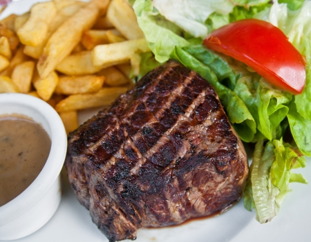 juicy steak beef meat with tomato and french fries Stock Photo - 10790385
