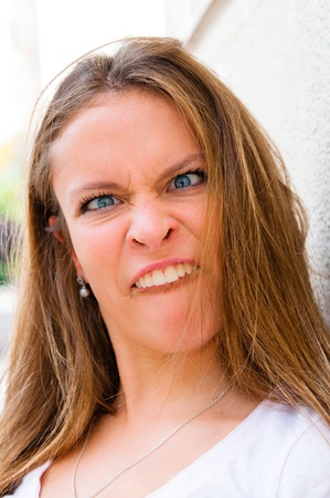 grimace: expression-Young woman making a funny grimace Stock Photo