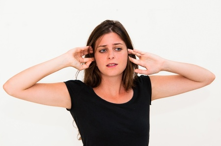 Young panic woman with hands on the head photo