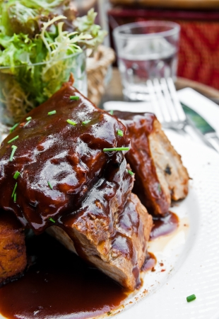 costela: Grilled steak - Grilled meat ribs on the plate with hot sauce