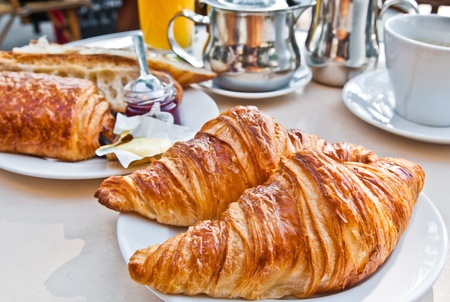 Breakfast with coffee and croissants in a basket on table Stock Photo - 10888853