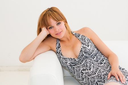 beautiful young woman on the couch in the living room Stock Photo - 10947617