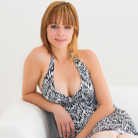beautiful young woman on the couch in the living room
