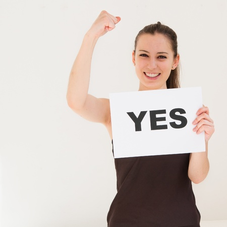 yes: happy portrait young woman with board yes Stock Photo