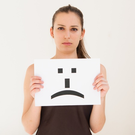 blank faces: portrait young woman with board sad emoticon face sign
