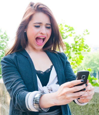 Young woman screaming with crazy expression Stock Photo - 10947595