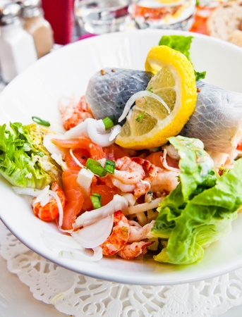 Fresh seafood salad with smoked salmon photo