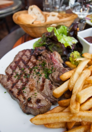juicy steak beef meat with tomato and french fries Stock Photo - 11301934