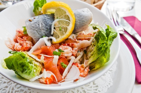 Fresh salmon salad with tomatoes photo