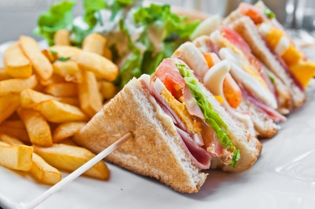 lunch tray: Sandwich with chicken, cheese and golden French fries potatoes