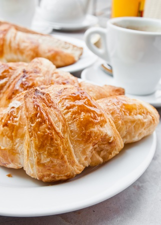 Breakfast with coffee and croissants in a basket on table Stock Photo - 11317776