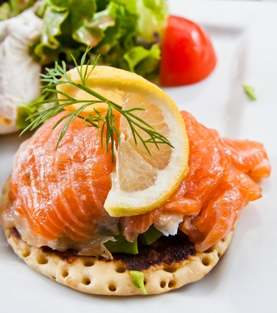 salmon and lemon - french cuisine dish with tomato and salmon photo