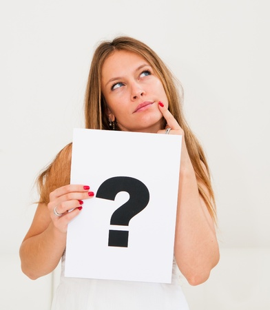 asking question: portrait young woman with board question mark sign Stock Photo