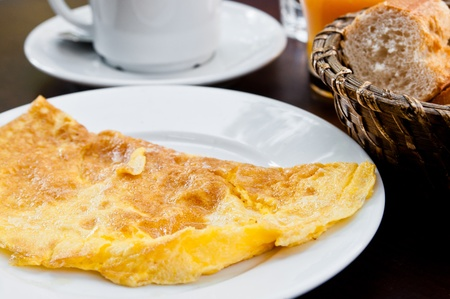 omelet with ham and hot coffee on table photo