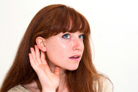 relying: Relying on hand-ear listening young woman Stock Photo
