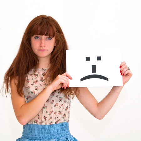 portrait young woman with board sad emoticon face sign photo