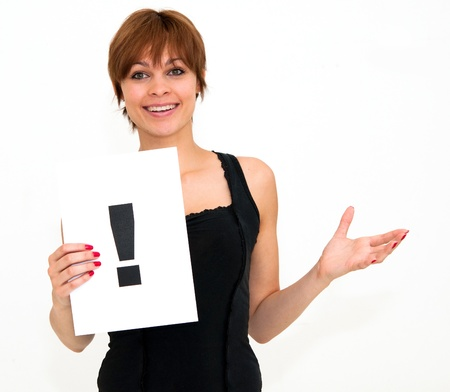 confused woman: portrait young woman with board exclamation point Stock Photo