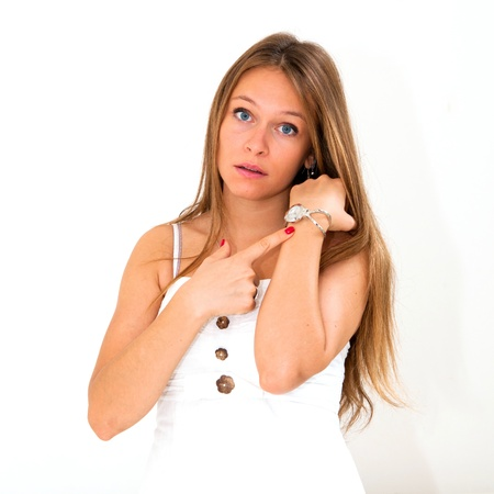 beautiful young woman checking the time on her wrist watch Stock Photo - 12334827