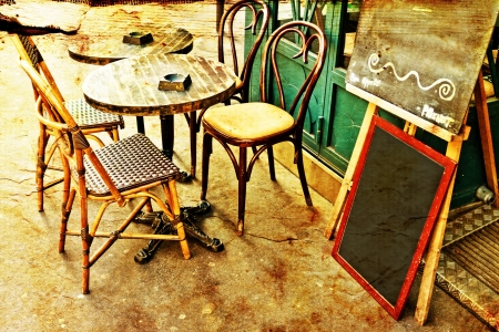 ambiance: old-fashioned Cafe terrace with tables and chairs,paris France Stock Photo