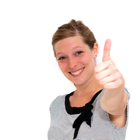 smiling beautiful happy woman with thumbs up photo