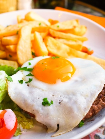Egg and fries - classical english breakfast with egg and fries Stock Photo