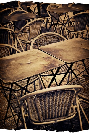 old-fashioned Cafe terrace with tables and chairs,paris France photo