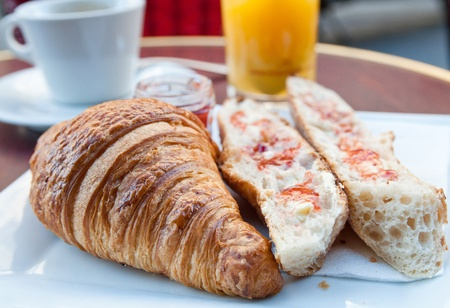 buttery: Breakfast with coffee and croissants on table Stock Photo