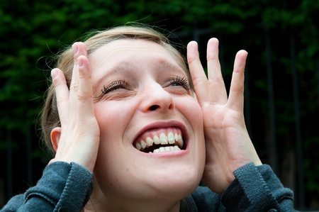 Young woman screaming with crazy expression photo