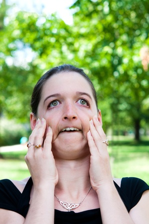 expression-Young woman making a funny grimace Stock Photo - 12377070