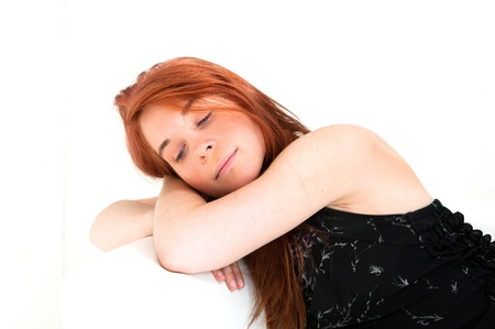 portrait of young woman holding her face on the couch in the living room Stock Photo - 12376992