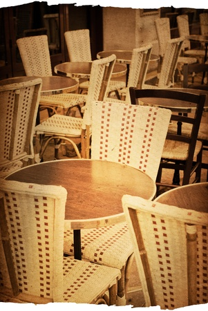 old-fashioned coffee terrace with tables and chairs,paris France Stock Photo - 12316314