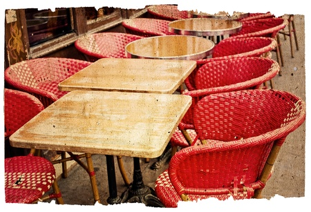 old-fashioned coffee terrace with tables and chairs,paris France photo