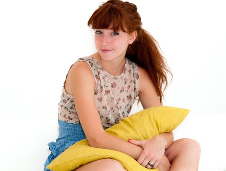 beautiful smile young woman with green pillow Stock Photo - 12626503